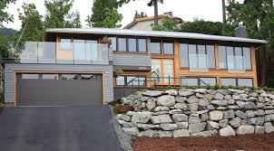 split level remodel for a transitional exterior with a driveway