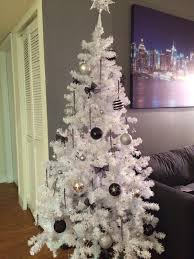white and silver decorated christmas tree home decorations