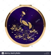 vintage stratton compact with peacock decoration stock photo