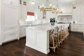 long kitchen island with six counter stools transitional kitchen