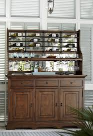 credenza with wine bottle rack and stemware storage by paula deen