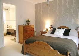 photo of beige grey pine bedroom with feature wall wallpaper