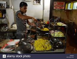 cooking indian style chinese food in a small restaurant in jorhat