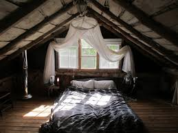 rustic style attic bedroom ideas with grey bed sheet on floor bed