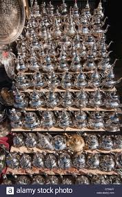 teapots for sale in the ancient medina in marrakech morocco stock
