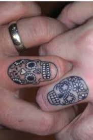 skull and flowers wedding ring tattoo design of tattoosdesign of