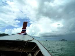 krabi and beyond of longtail boats heavy rain and amazing