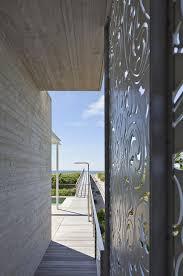 hamptons beach house with elegant metal screen