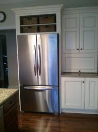 wine rack cabinet over refrigerator space above fridge idea i like this or making it into a wine rack