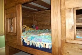 Rustic Bunk Beds And Living Quarters Of A Fur Trade Era Log Cabin - Rustic wood bunk beds