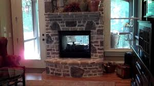 sitting room with built in bookcases two sided fireplace and