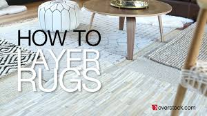 how to layer rugs in 5 easy steps overstock com youtube