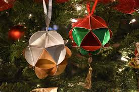 geometric paper ornaments change is beckoning