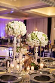 tree branch centerpieces reception décor photos centerpieces grouped on table