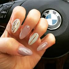 my fav so far stiletto style gel extensions in beige and off white