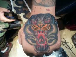 hand tiger tattoo by bobby rotten