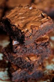 flourless double chocolate brownies running with spoons