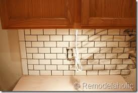 Remodelaholic White Subway Tile Back Splash Tutorial - No grout tile backsplash