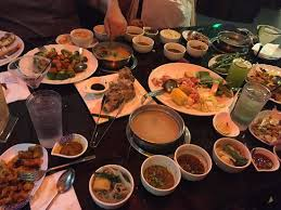 table full of food table full of food pot and dishes picture of sichuan pot