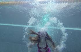 women practice swimming as mermaids in russia