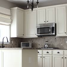 why is everyone painting their kitchen cabinets white from to still great painted cabinets one year later