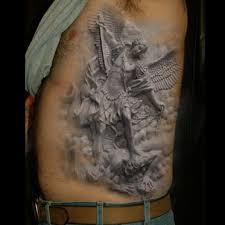 grey ink graffiti tattoo on ribs for men photo 3 photo