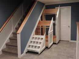 Under Stairs Shelves by Modern Storage Under Stair With Plaid White Shelves And Glass