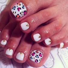 gold studded toenails accented with leopard print toe nail art