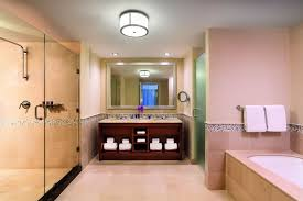 executive suite in aruba the ritz carlton aruba a marble bathroom with a large glass enclosed walk in shower a tub