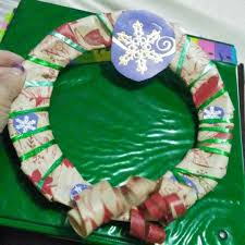 recycled christmas wrapping paper a recycled christmas wrapping paper wreath thriftyfun