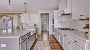 white shaker kitchen cabinets backsplash white shaker kitchen cabinets with white subway tile backsplash