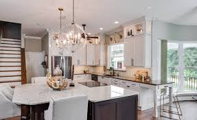kitchen cabinet decorating ideas stylish ways to put the space above your kitchen cabinets to