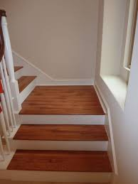 laminate flooring in a wood pattern against white banisters