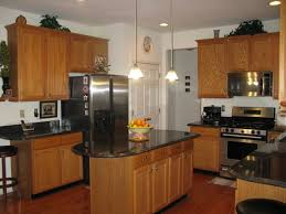 what color granite goes with honey oak cabinets 37 best granite countertops with oak cabinets images on pinterest