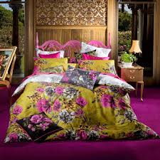 mustard yellow fuschia floral and slate grey print bedding to ad