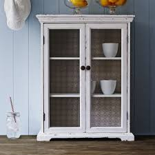vintage cream wooden cabinet with a wallpaper backing two