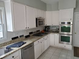 tips for spray painting kitchen cabinets tips for repainting kitchen cabinets dengarden