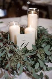 winter wedding centerpieces winter tennessee warehouse wedding greenery wreath winter