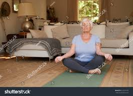 Livingroom Yoga Active Focused Senior Woman Sitting Lotus Stock Photo 613477193