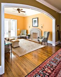 can you share the warm yellow orange paint color of this room