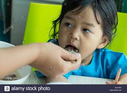 kids writing paper illness asian kids writing paper on desk and eating cereal saline illness asian kids writing paper on desk and eating cereal saline intravenous iv on hand