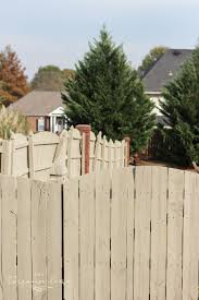 how to paint a wood fence the fast and easy way