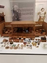 a miniature japanese kitchen with many accessories on display at