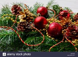 garland with ornaments and golden pine cones