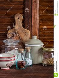 kitchen still life olive chopping board glass jar with flour
