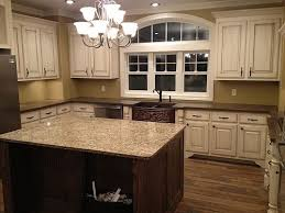 antique beige kitchen cabinets white molding and distressed cabinets with wood floors farmhouse