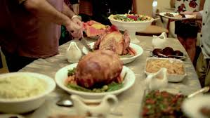 thanksgiving table with turkey and side dishes and carving