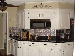 backsplash for black and white kitchen get a tin kitchen backsplash custom installed decor trends