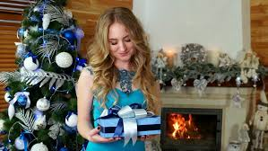 beauty opens christmas gift box with miracle christmas gift