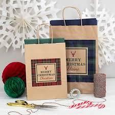 large christmas gift bags large personalised christmas gift bag tartan kraft party
